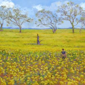 A immense field full of yellow mustard flowers, is extending to the horizon