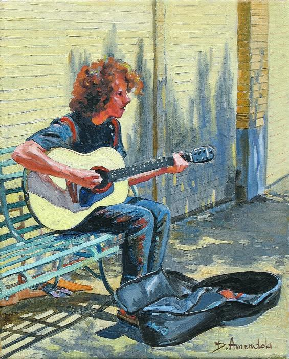 A young guitarist sitting on a bench in the street is playing for coins.