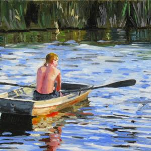 A young man is rowing on the river surrendered with tall grass