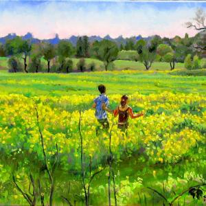 A couple is running through the field care free and close to nature.