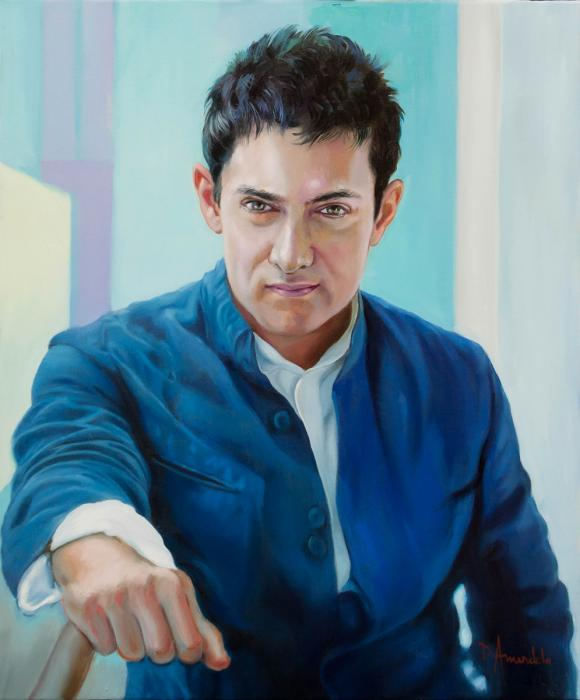 Aamir Khan is seen with a blue suite.His eyes are sparkling.